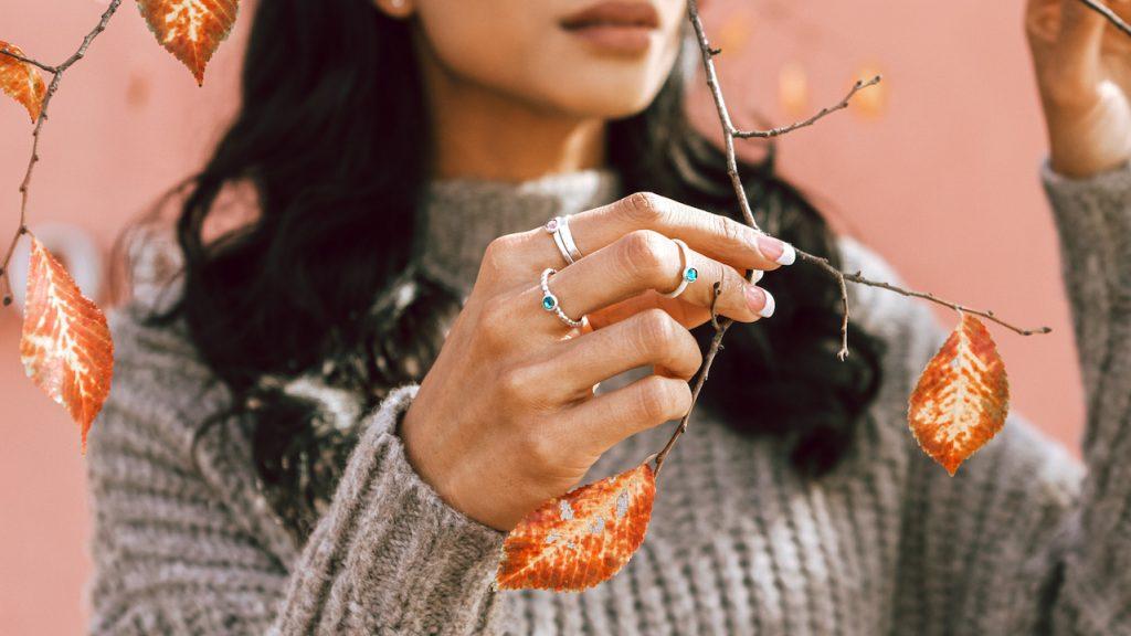 Model wearing the birthstone rings