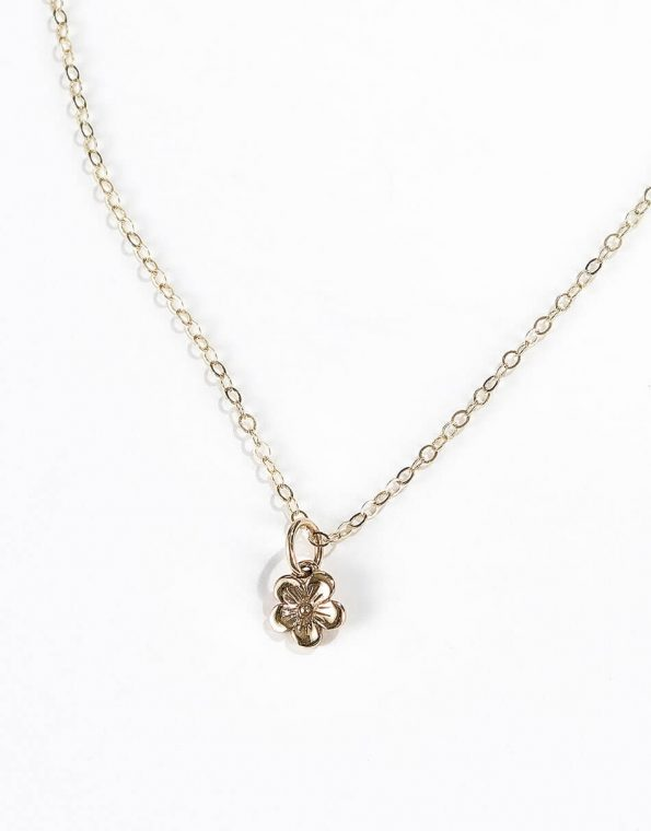 A beautiful dainty yellow bronze flower hung on gold-filled chain. Perfect gift for daughter, sister, friend