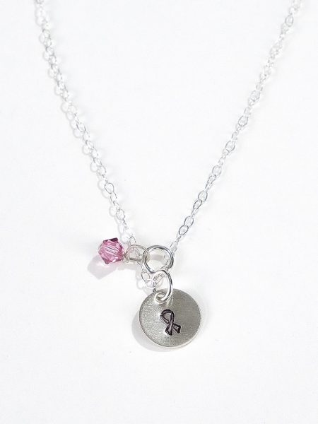 Individually hand stamped beautiful sterling silver disc with a ribbon. A sweet Swarovski crystal adds the perfect touch to it.
