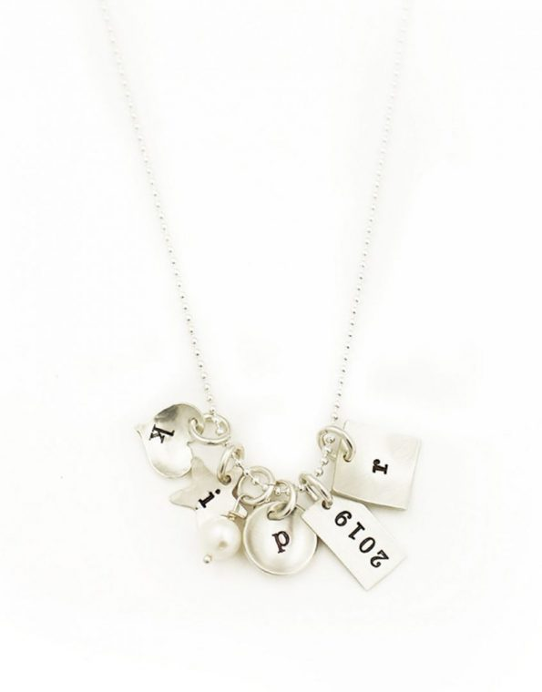 Sterling Silver Necklace with heart charm, circle charm, rectangle charm and square charm. 3 charms have Initial letter engraved and one charm has year engraved. Necklace has a pearl attached.