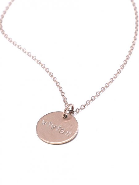 A dainty rose gold circle hung in the rose gold chain with engraved name. Gift this to a mom, sister or a friend.