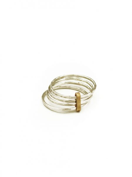 "A golden metal ""tie"" binds together sterling silver rings. Great gift for mom, grandma, wife, sister"