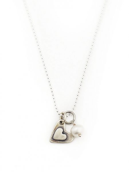 "2 small sterling hearts layered with a simple message hand stamped ""i love you more"". Perfect gift for wife, fiancee"