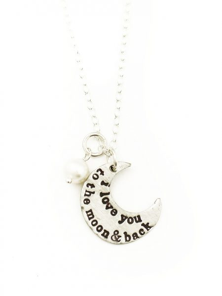 "A moon charm hand stamped with ""I love you to the moon and back"" on one side and a simple heart on the other side."