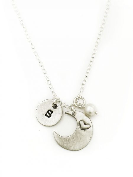 "A moon charm with ""I love you to the moon and back"" on one side and a simple heart on the other along with a circle disc hand stamped with initial"