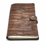 A custom journal with hand stamped quote or a scripture along with a name or a date. Perfect gift for friends, co-workers