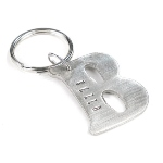 Handmade letter keychain with engraved names. Great gifting option for a person of any age