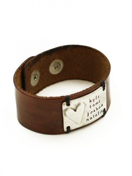 A chunky leather cuff with a handmade pewter charm with message engraved on it. Perfect for husband, dad, brother, son