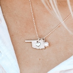 Show off your love for your state with this home state love necklace. Hung on a sterling silver chain with a freshwater pearl.