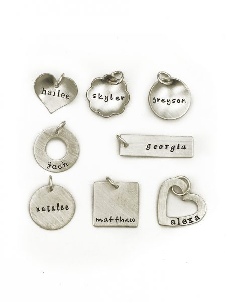 A medium size charm hand stamped with the name on a shape of your choice. Best gift for wife, daughter, friend, sister