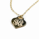 "A beautiful ""Tiffany"" style heart that is gold plated created with your choice of monogram. Perfect gift for mom, wife, friend"