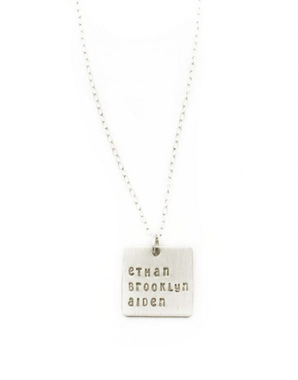 A sterling silver square charm necklace with names engraved on it. Perfect gift for a mom, grandma or spouse